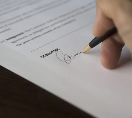 Powers of Attorney document being signed