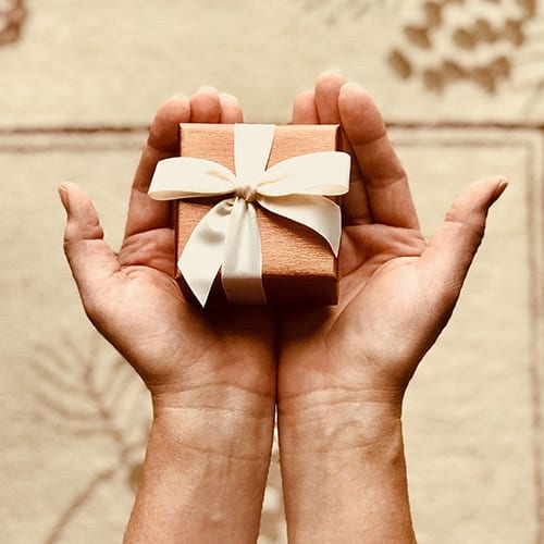 Employment Tax image - Gift in the hands