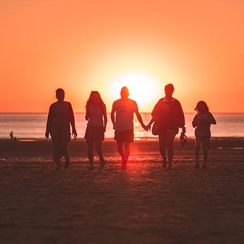 Inheritance Tax - family walking down the beach