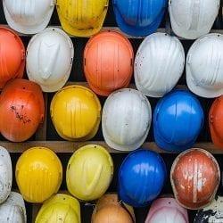 Colourful helmets on a wall