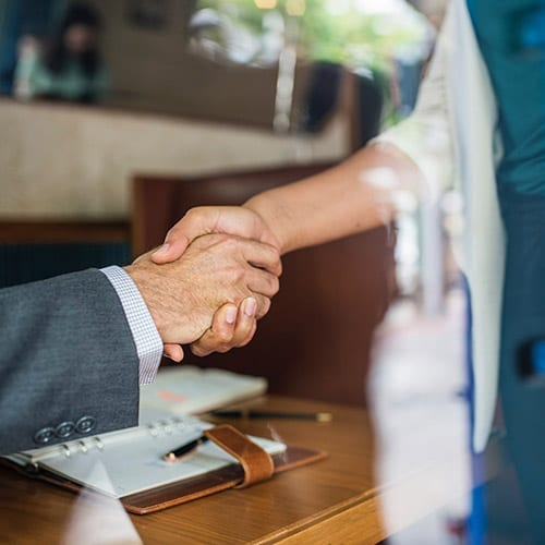 Shaking hands - Business Tax Page