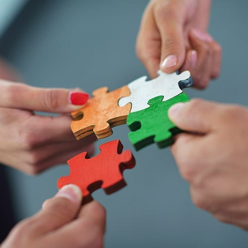 Business Tax image - Hands holding a puzzle