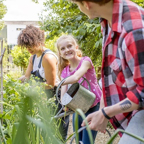 Charities and Not-for-Profit image - family watering a garden