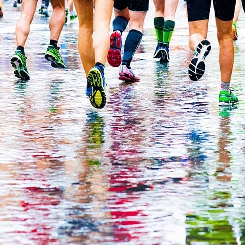 runners in marathon abstract legs