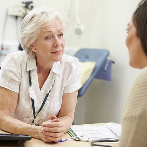 Doctor or Consultant talking to patient