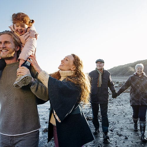 Family walking down the beach - Trusts and Estates page