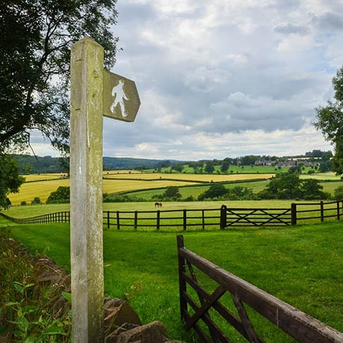 Landed estates image - fence and sign post in a field