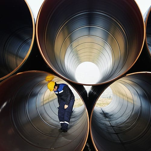 Manufacturing and engineering image - man in big steel tubes