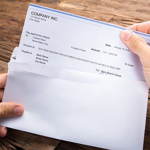 Payroll - person opening payroll slip