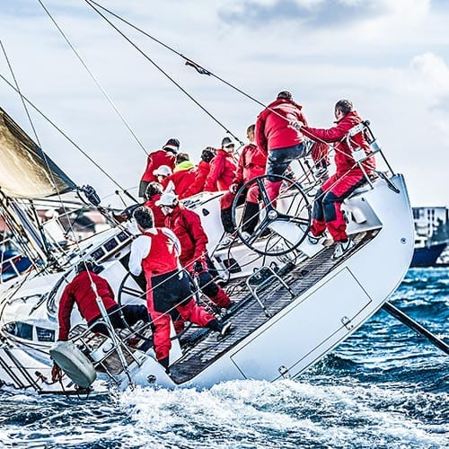 Professional sports image - Sailing team action shot in a race