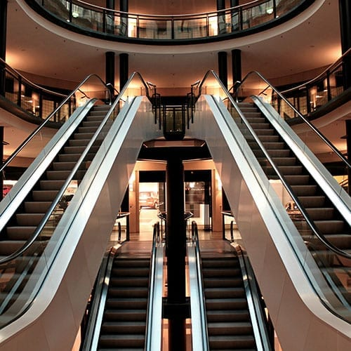 Capital allowances Image - a photo of escalators in a shopping mall