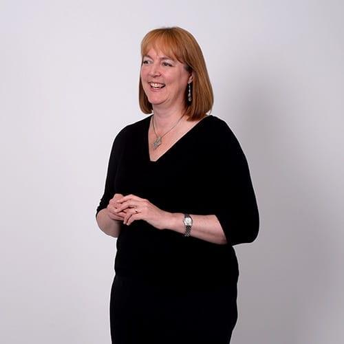 Sharon Austen - Portrait image with grey background