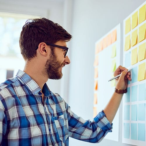 Planning Image - Man Scribing Onto Postit Notes