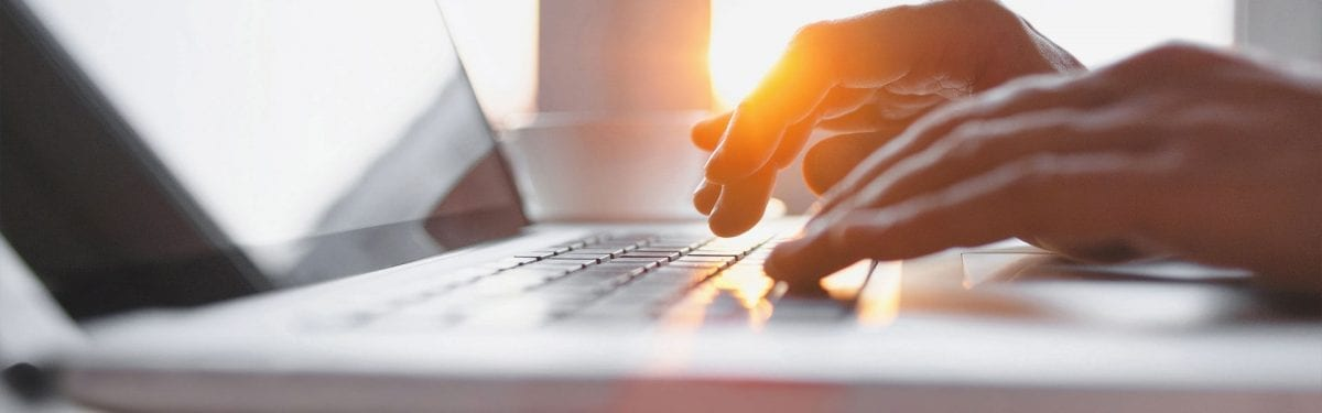 Close Up Of Hands Working On A Laptop