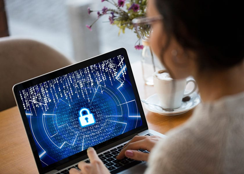 Cyber Security Woman On Laptop With Padlock On Screen